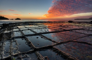 Sunrise on the tessellated pavement illustrating the pan formation of tessellation