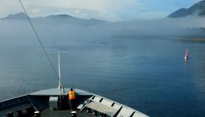 Seaman watching for obstacles in the Wrangell Narrows
