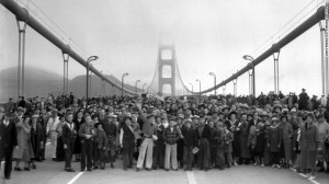 Pedestrians walk across the bridge on May 27, 1937