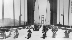 The first vehicles, led by a police escort, cross the bridge and head south into San Francisco on May 28, 1937