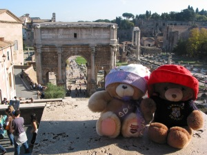 Puffles and Honey in 2007 at the Roman Forum, with the three columns from the Temple of Vespasian and Titus (right) and the Arch of Septimius Severus (center). Ruins of the Temple of Saturn not visible in the photo.