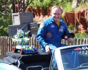 Astronaut Mike Finke rides in a Chevrolet Camaro for the welcome home parade for Buzz Lightyear at Disney's Magic Kingdom. Finke was the Expedition 18 commander on the International Space Station during part of the toy's 15-month stay on the orbiting laboratory.