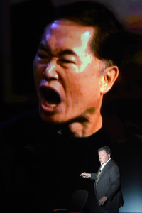 "William Shatner shows an image of George Takei from the ""Comedy Central Roast of William Shatner"" during his one-man show, ""Shatner's World: We Just Live In It."""
