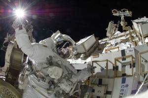 NASA astronaut Sunita Williams, Expedition 32 flight engineer, appears to touch the bright sun during the mission's third spacewalk. During the six-hour, 28-minute spacewalk, Williams and Japan Aerospace Exploration Agency astronaut Aki Hoshide (visible in the reflections of Williams' helmet visor), flight engineer, completed the installation of a Main Bus Switching Unit (MBSU). They also installed a camera on the International Space Station's robotic arm, Canadarm2. Credits: NASA