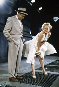 "Marilyn Monroe breezes through filming with her ""Seven Year Itch"" co-star Tom Ewell in a photograph by Sam Shaw. It was Shaw's idea to orchestrate the flying skirt image and use it to promote the movie. (Photo © Sam Shaw Inc. licensed by Shaw Family Archives)"