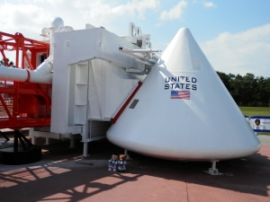 Apollo Command Module Model with the 'White Room' hugging it