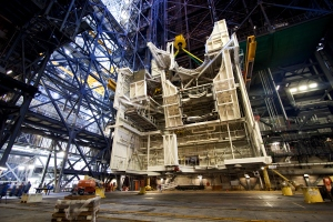 A large space shuttle-era work platform is being removed from high bay 3 of the VAB on Oct. 24, 2012. Credits: NASA