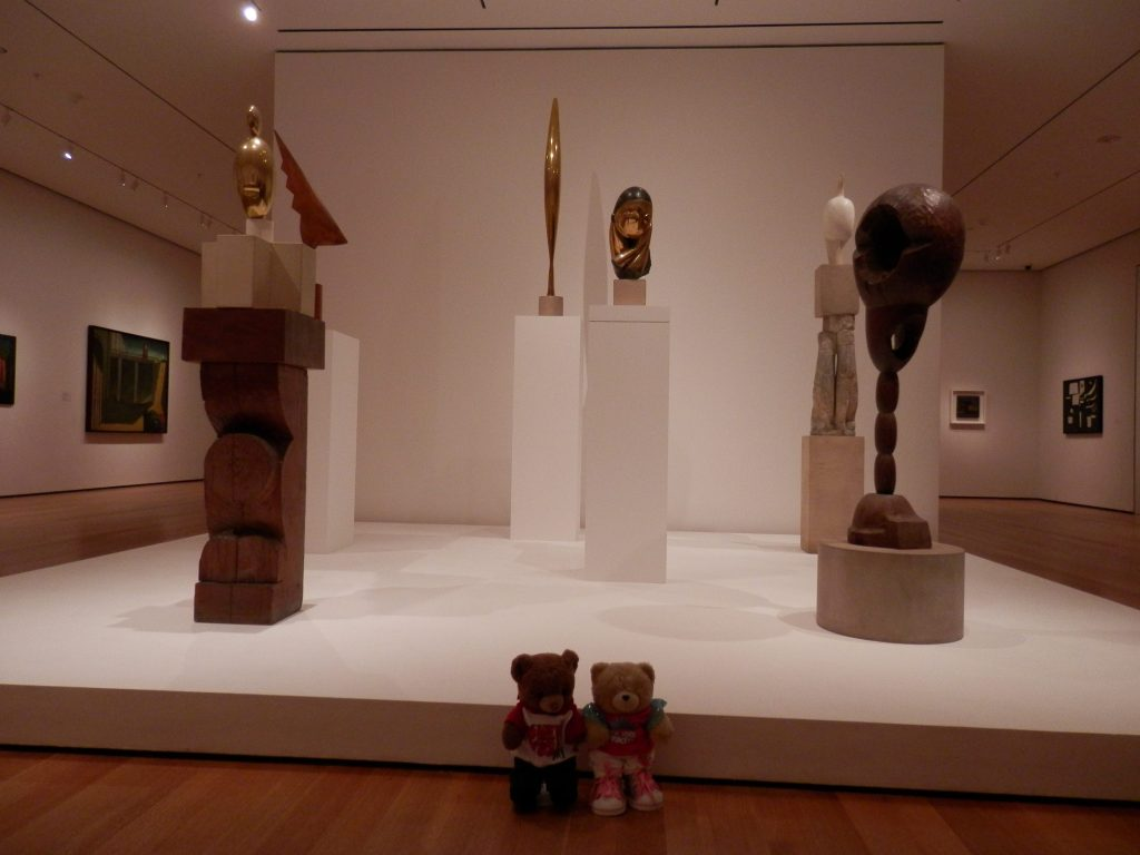 MoMA (from left to right) Blond Negress, II, 1933 (Bronze on four-part pedestal of marble, limestone, and two oak sections carved by Brâncuși) The Cock, 1924 (Cherry) Bird in Space, 1928 (Bronze) Mlle Pogany version I, 1913 (Bronze with black patina on limestone base) Maiastra, 1910-12 (White marble on three-part limestone of which the middle section is double caryatid c. 1908) Socrates, 1922 (Oak on oak footing with limestone cylinder)