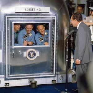 Apollo 11 crew in quarantine. President Richard M. Nixon was in the central Pacific recovery area to welcome the Apollo 11 astronauts aboard the USS Hornet, prime recovery ship for the historic Apollo 11 lunar landing mission.