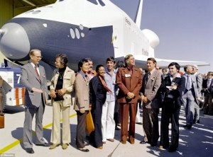 In 1976, the Star Trek cast posed with Enterprise - named after Captain Kirk's and Spock's craft. L-R: NASA's James D. Fletcher, DeForest Kelley (Dr. McCoy), George Takei (Mr. Sulu), James Doohan (Scotty), Nichelle Nichols (Lt. Uhura), Leonard Nimoy (Mr. Spock), Gene Rodenberry (creator of Star Trek), an unidentified man, and Walter Koenig (Ensign Pavel Checkov)