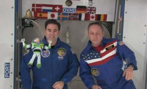 Buzz Lightyear on orbit with fellow crewmembers Greg Chamitoff and Mike Finke. NASA Photograph