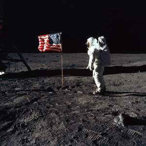 Astronaut Buzz Aldrin poses for a photograph beside the deployed United States flag during Apollo 11 Extravehicular Activity (EVA). NASA Photograph.