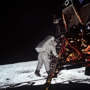 Astronaut Edwin E. Aldrin Jr., lunar module pilot, descends the steps of the Lunar Module (LM) ladder as he prepares to walk on the Moon.
