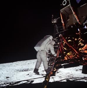 Astronaut Edwin E. Aldrin Jr., lunar module pilot, descends the steps of the Lunar Module (LM) ladder as he prepares to walk on the Moon.