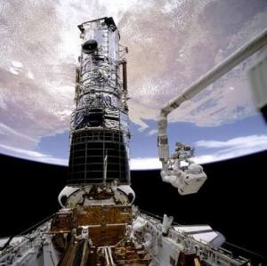 The first servicing mission to the Hubble Space Telescope saw astronauts install a set of specialized lenses to correct the flawed main mirror in the telescope. NASA Photograph