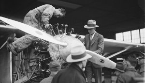 Charles Lindbergh (in fedora) and a mechanic check out the Spirit of St. Louis' engine circa 1927. (Library of Congress)