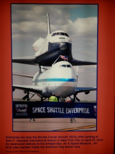 Enterprise sits atop the Shuttle Carrier Aircraft 905 (on display at Independence Plaza, Space Centre Houston) after landing at John F. Kennedy International Airport in New York City on April 27, 2012 for ceremonial delivery to the Intrepid Sea, Air & Space Museum.