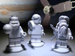 The three Lego figures orbiting Jupiter - Galileo, holding a telescope, Juno, holding a magnifying glass of discovery and Jupiter, holding lightning