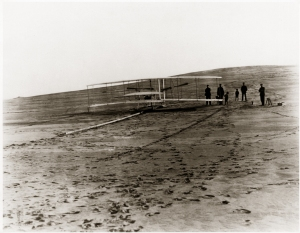 "The 1903 Wright Flyer rests atop the ""Grand Junction Railroad"", ready for flight"