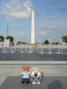 Fountain at the World War II Memorial with the Washington Monument behind