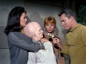 The legend begins: in the first pilot, Jeffrey Hunter (right) as Capt. Pike and Majel Barrett as Number One swap views with an inhabitant of the planet Talos IV. (CBS Photo Archive / Getty Images)