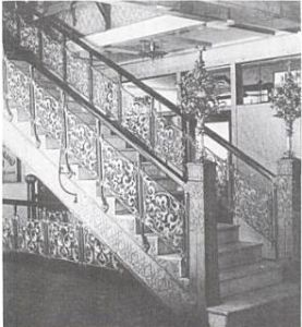 Montauk Building,  1891, by Burnham & Root - the decorative cast aluminum staircases were the first use of aluminum in building construction.