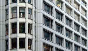 """Sullivan Centre - detail of terracotta exterior with """"Chicago"""" windows at right"""
