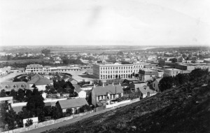 Panoramic view of the Los Angeles Plaza in 1876. The Pico House is the prominent 3-story white building at the center of the photo. The Los Angeles River can be seen in the background.