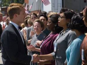 Astronaut John Glenn (Glen Powell) and Katherine Johnson (Taraji P. Henson)