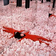 Yayoi Kusama, Installation view of Infinity Mirror Room—Phalli's Field, 1965, in Floor Show, Castellane Gallery, New York, 1965.  Sewn stuffed cotton fabric, board, and mirrors. Courtesy of Ota Fine Arts, Tokyo/Singapore; Victoria Miro, London; David Zwirner, New York. ©