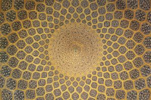 The interior side of the dome. The decoration seems to lead the eye upwards toward its center, as the rings of ornamental bands filled with arabesque patterns become smaller and smaller. (Wikipedia)